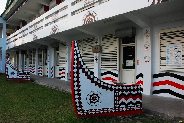 cute elementary school with symbolic canoes